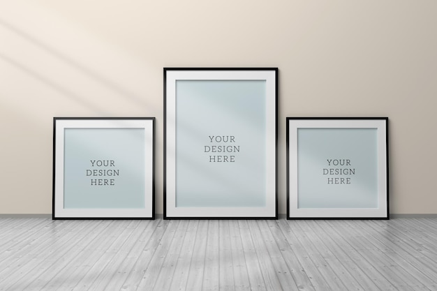 Editable psd mockup with three black blank frames a4 and 1 to 1 size standing on wooden floor