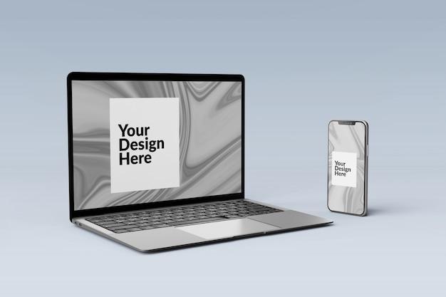 編集可能なセットのデジタルデバイス画面のスマートフォンとラップトップのモックアップ