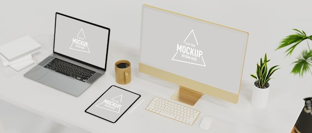 Electronic device in workspace laptop mockup tablet mockup computer mockup on white table