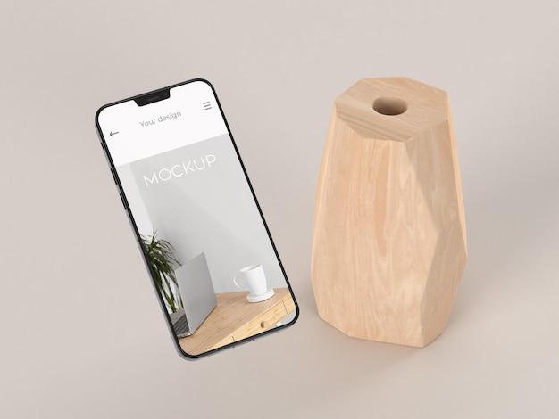 モックアップスマートフォンと花瓶でエレガントなアレンジメント