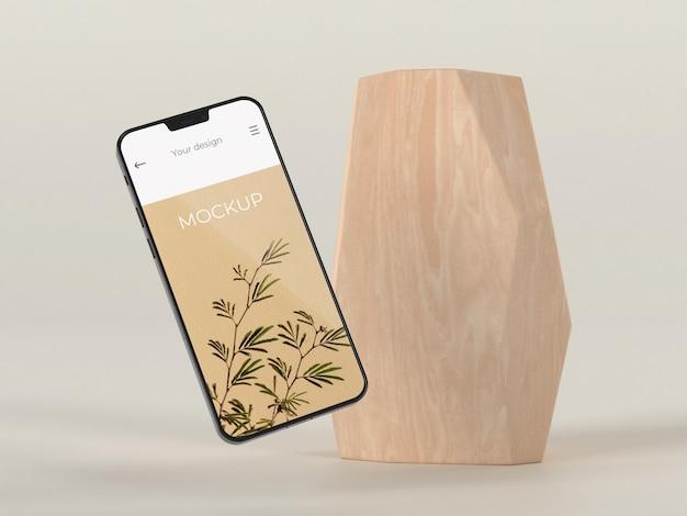 Elegant arrangement with mock-up smartphone and vase