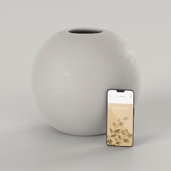 Elegant assortment with mock-up smartphone and vase