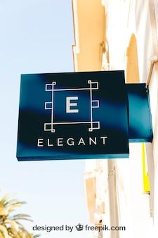 Elegant blue shop sign mockup Free Psd