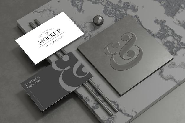 3d 렌더링에서 로고 브랜딩 쇼케이스가있는 우아한 명함 모형