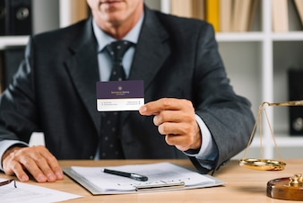 Elegant businessman presenting business card mocku