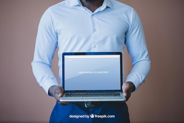 Elegant businessman presenting laptop