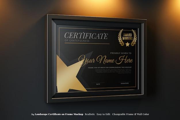 Elegant certificate mockup on black frame a4 landscape hanging in luxury dark interior
