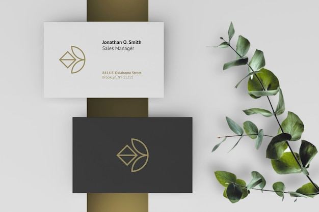 Elegant dark and white business card mockup with plants as background