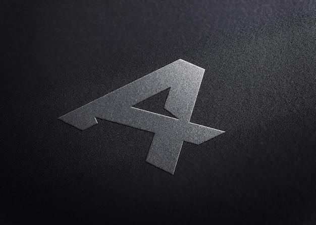 Elegant embossed logo mockup on black paper