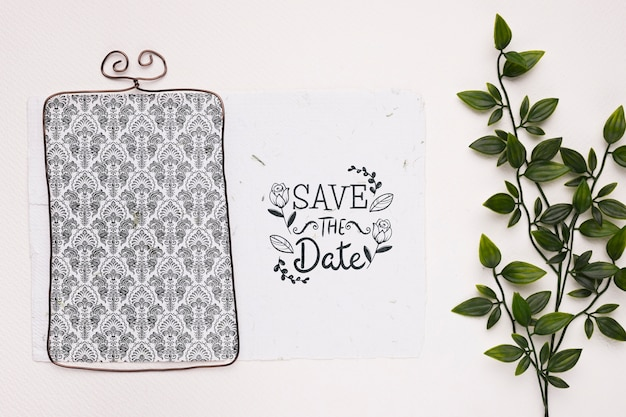 Elegant frame and plant save the date mock-up