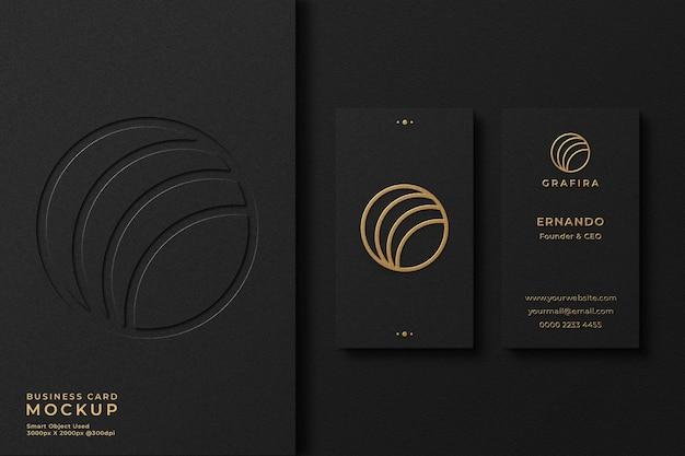 Elegant gold foil black business card mockup with emboss effect and letterpress logo on background
