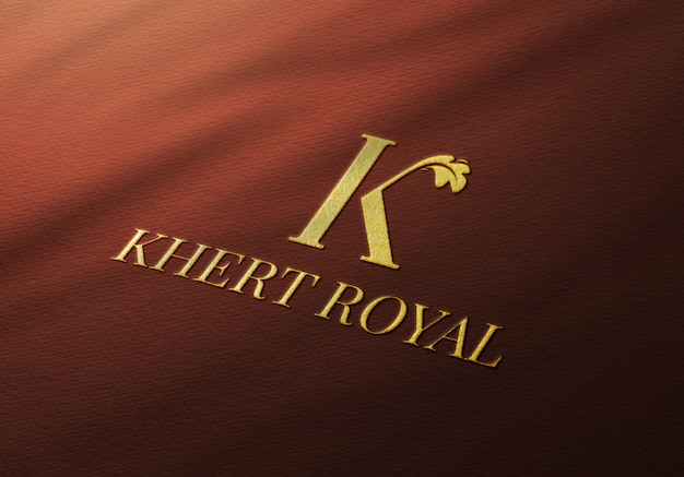Elegant golden logo mockup on red fabric
