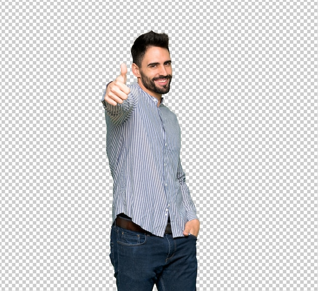 Elegant man with shirt giving a thumbs up gesture because something good has happened