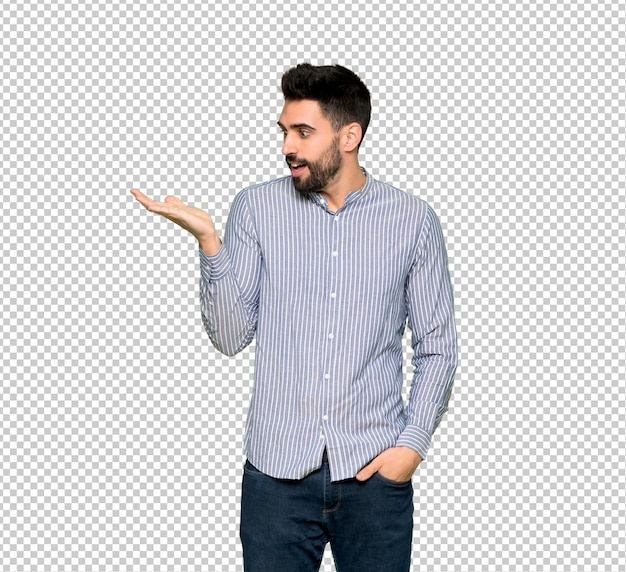 Elegant man with shirt holding copyspace imaginary on the palm to insert an ad