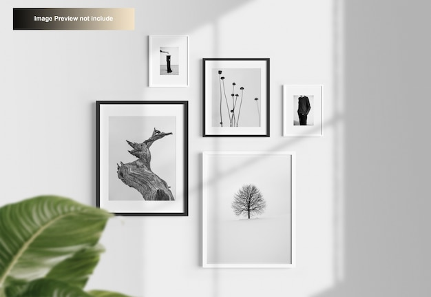 Elegant minimal photo frames mockup hanging on wall