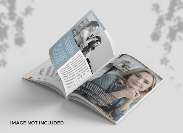 Elegant opened magazine from top view mockup