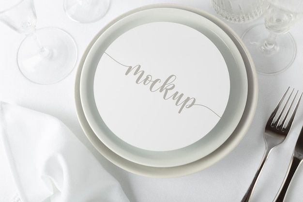 Elegant tableware composition with round mock-up card