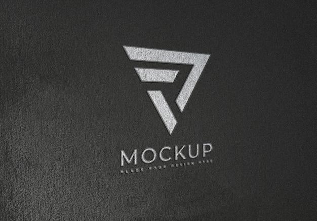 Emboss logo mockup on black texture surface