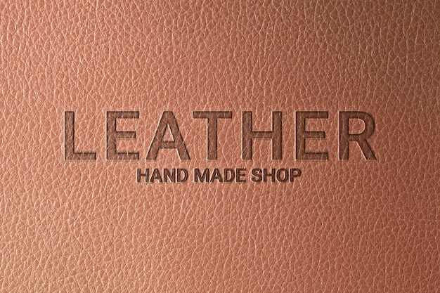 Emboss logo mockup psd for company on brown leather background