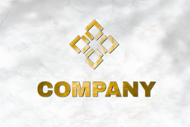 Emboss logo mockup psd in gold for company with tag line here text