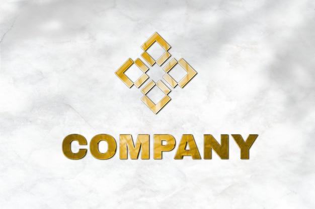 ここにタグラインのある会社の金のエンボスロゴモックアップpsdテキスト 無料 Psd