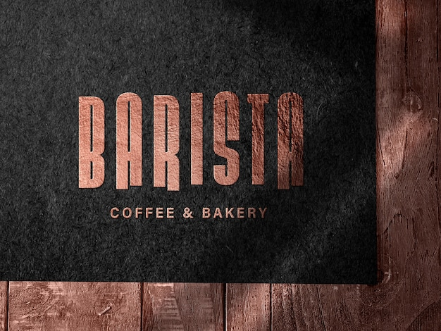 Embossed bronze logo mockup on dark paper