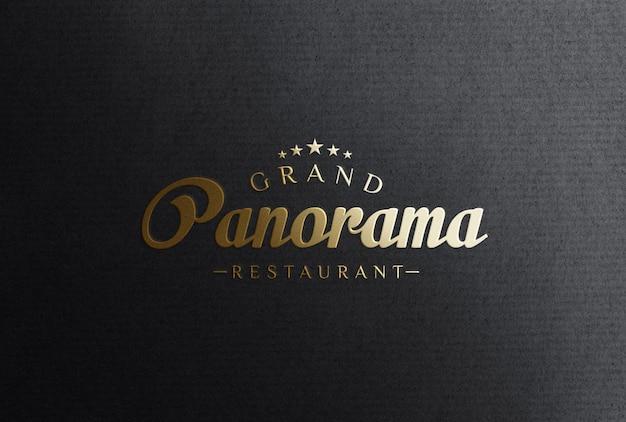 Embossed gold foil stamping logo mockup on black paper
