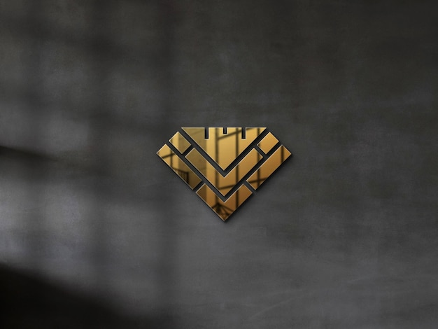 Embossed gold logo mockup on a concrete wall