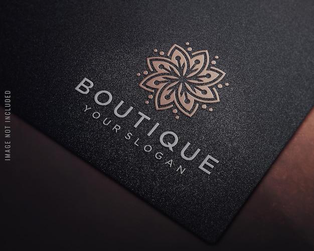 Embossed logo mockup on black fabric