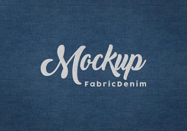 Embossed logo mockup on blue fabric texture