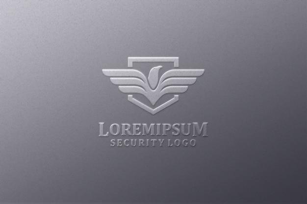 Тиснение логотипа макет в черной бумаге