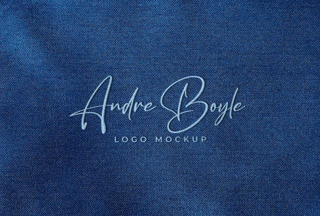 Embroidered stitched logo mockup on blue fabric