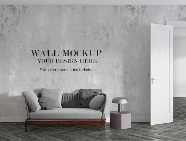 Пустая стена с макетом позади небольшого дивана