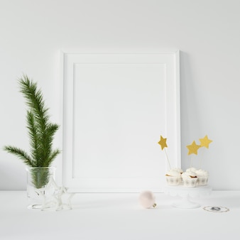 Empty photo frame and decorative branches
