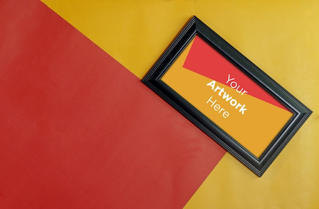 Empty photo frame mockup design on red and yellow paper background