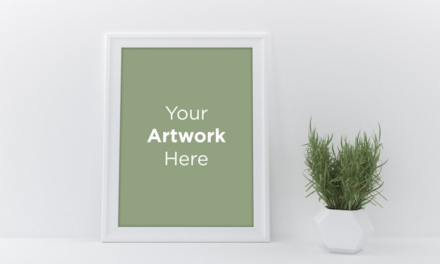 Empty photo frame mockup design on white wall with vase and plant