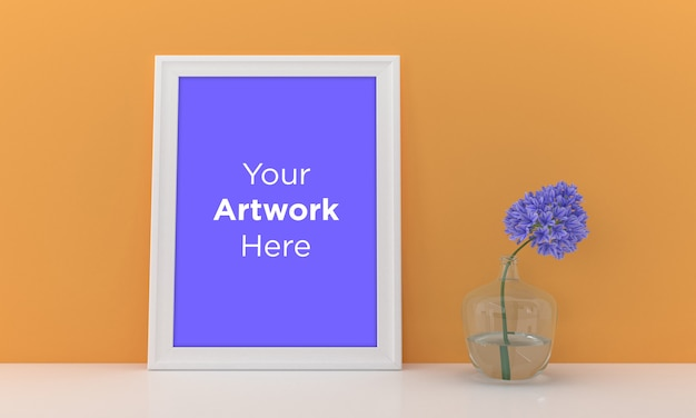 Empty photo frame mockup design with yellow wall and purple flower