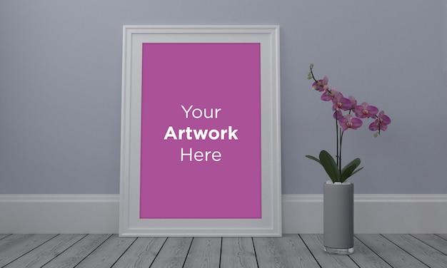 Empty photo frame with flower in vase mockup design