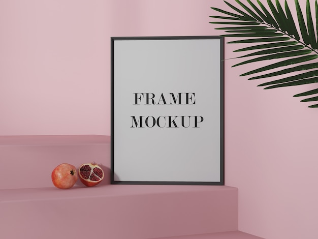 Empty picture frame mockup beside pomegranate
