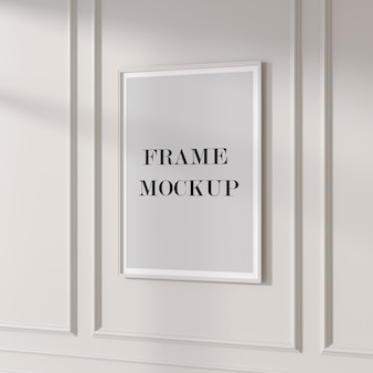Empty poster frame mockup on the wall
