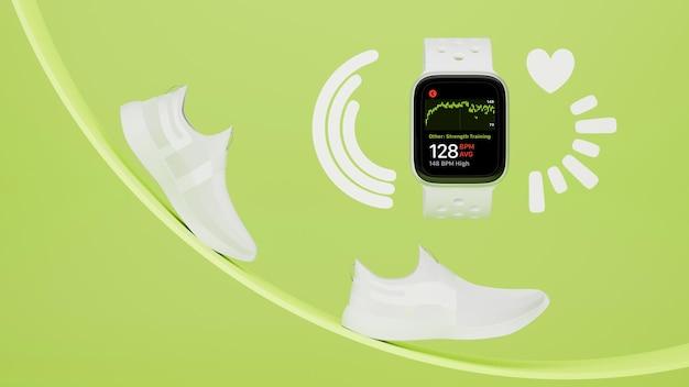 흰색 운동화와 녹색 배경의 기하학적 모양이 있는 빈 화면 스마트워치 모형