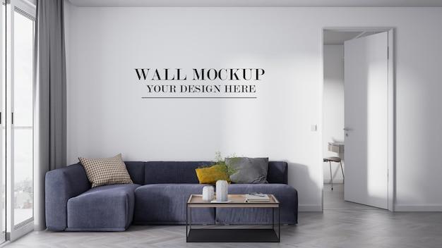 Пустая стена фон за темно-синим угловым диваном