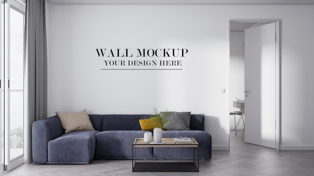 Empty wall background behind navy blue corner sofa