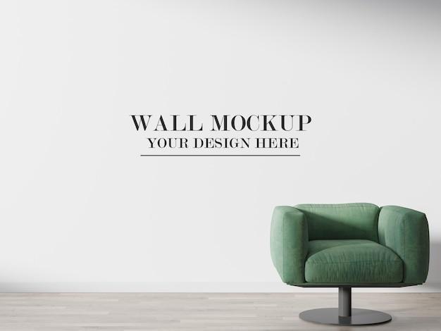Empty wall mockup behind green sofa