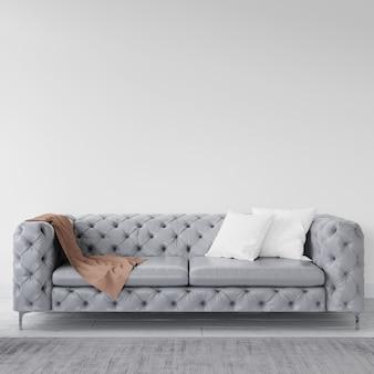 Empty wall with elegant sofa