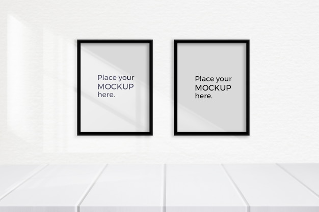 Empty white room with frames mockup on the wall