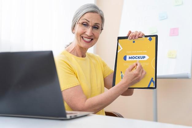 English teacher holding a mock up clipboard