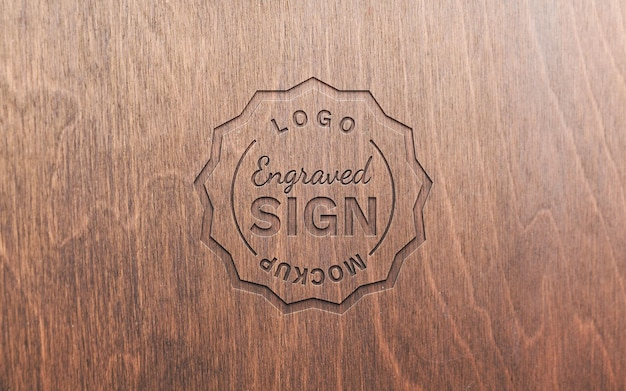 Engraved logo on wooden surface mockup