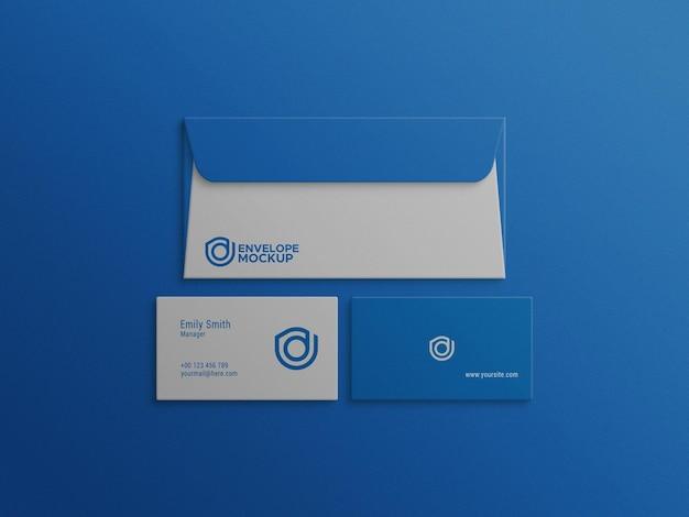 Envelope with business card blue color mockup