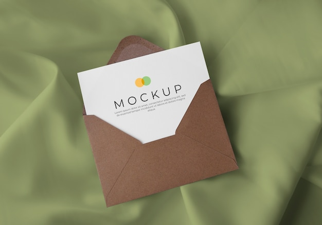 Envelope with card on fabric background mockup
